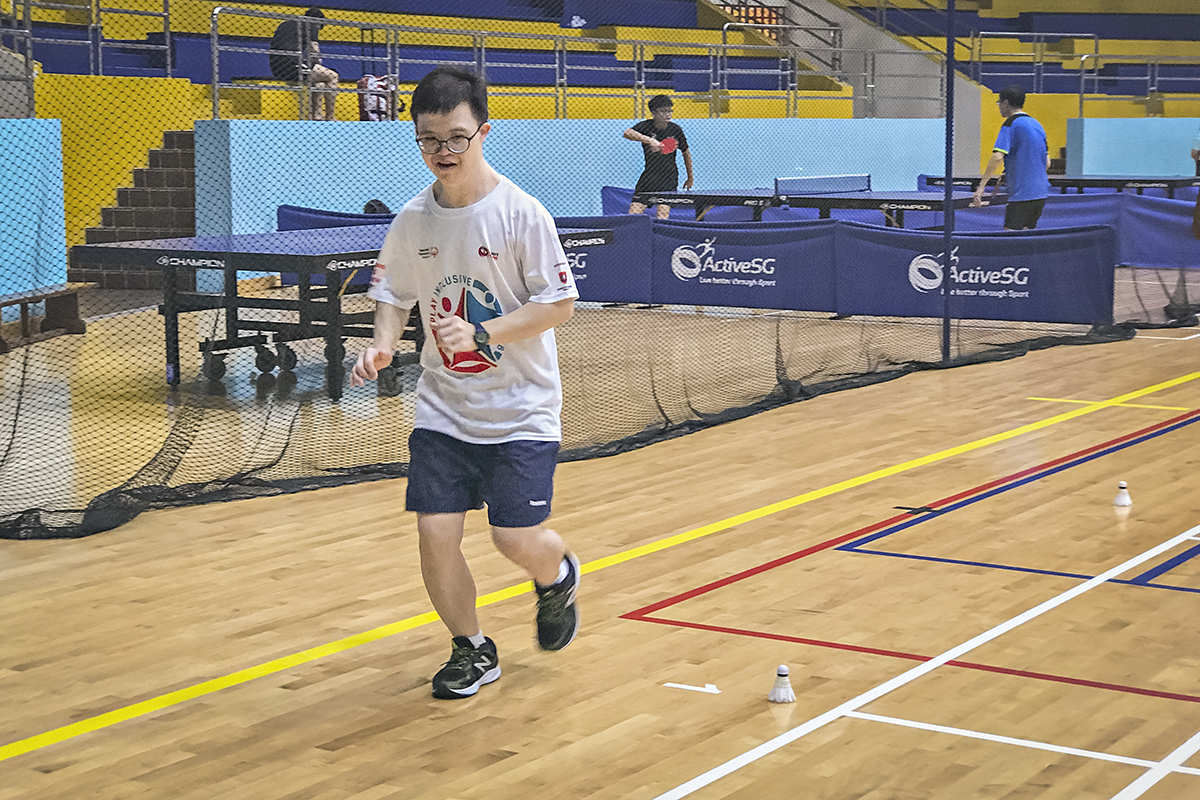 Johannes Cheong, Special Olympics Asia Pacific athlete, running in a badminton court during a practice session.
