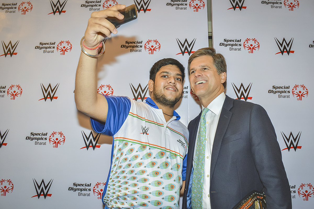 Shrey Kadian, athlete from Special Olympics Bharat in India taking a selfie with Timothy Shriver, Chairman of Special Olympics