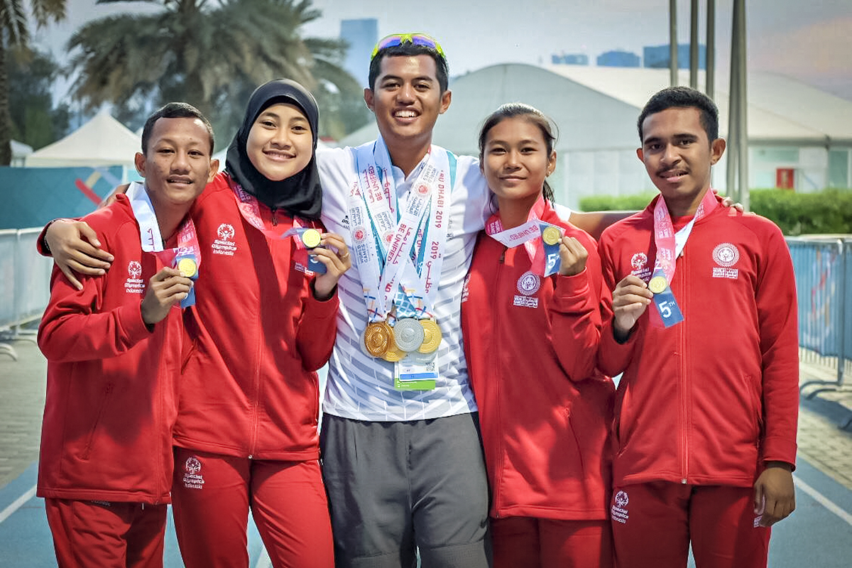 Williems Doroh, a Special Olympics Asia Pacific athlete, with his Indonesian teammates at the World Games in Abu Dhabi